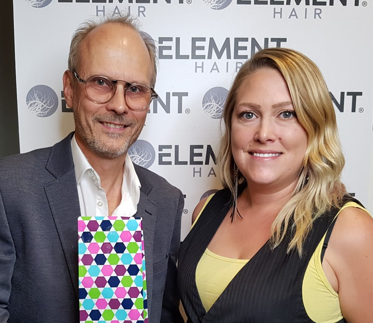 Kristie's 4 year Anniversary with Element Hair! (Left) Lance Nielsen, co-owner and director, presents (right) Kristie with a gift in recognition of her achievement.